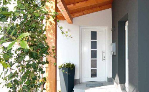 Pose d'une porte d'entrée bois aluminium à Saint-Symphorien-d'Ozon et sa région.